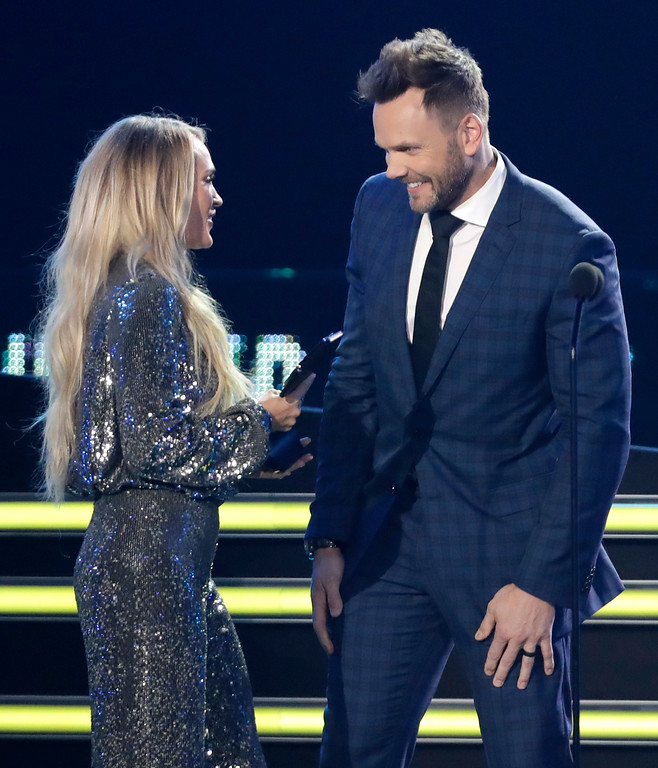 . Carrie Underwood accepts the female video of the year award from presenter Joel McHale at the CMT Music Awards at the Bridgestone Arena on Wednesday, June 6, 2018, in Nashville, Tenn. (AP Photo/Mark Humphrey)