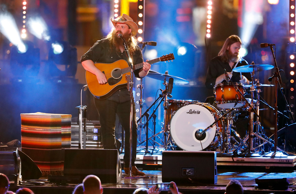 ". Chris Stapleton performs ""Millionaire\"" at the CMT Music Awards at the Bridgestone Arena on Wednesday, June 6, 2018, in Nashville, Tenn. (AP Photo/Al Wagner)"