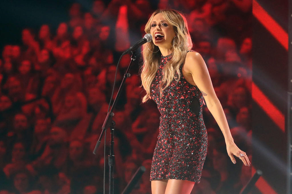 ". Carly Pearce performs ""Hide the Wine\"" at the CMT Music Awards at the Bridgestone Arena on Wednesday, June 6, 2018, in Nashville, Tenn. (AP Photo/Mark Humphrey)"