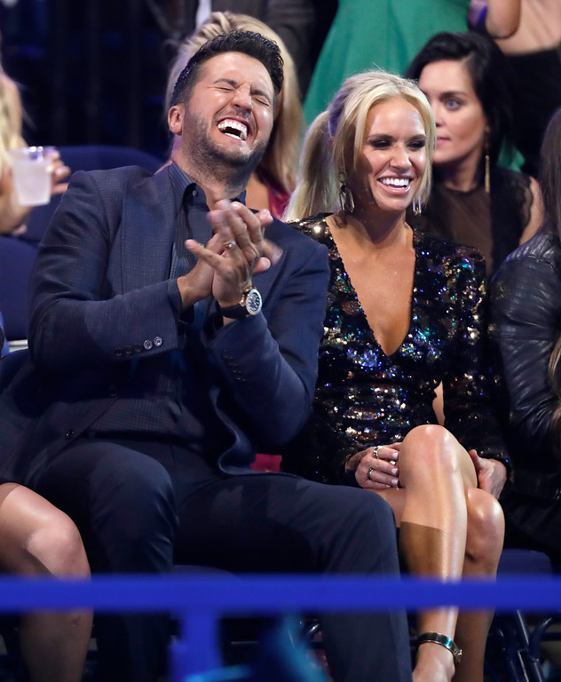 . Luke Bryan, left, and Caroline Boyer appear in the audience at the CMT Music Awards at the Bridgestone Arena on Wednesday, June 6, 2018, in Nashville, Tenn. (AP Photo/Mark Humphrey)