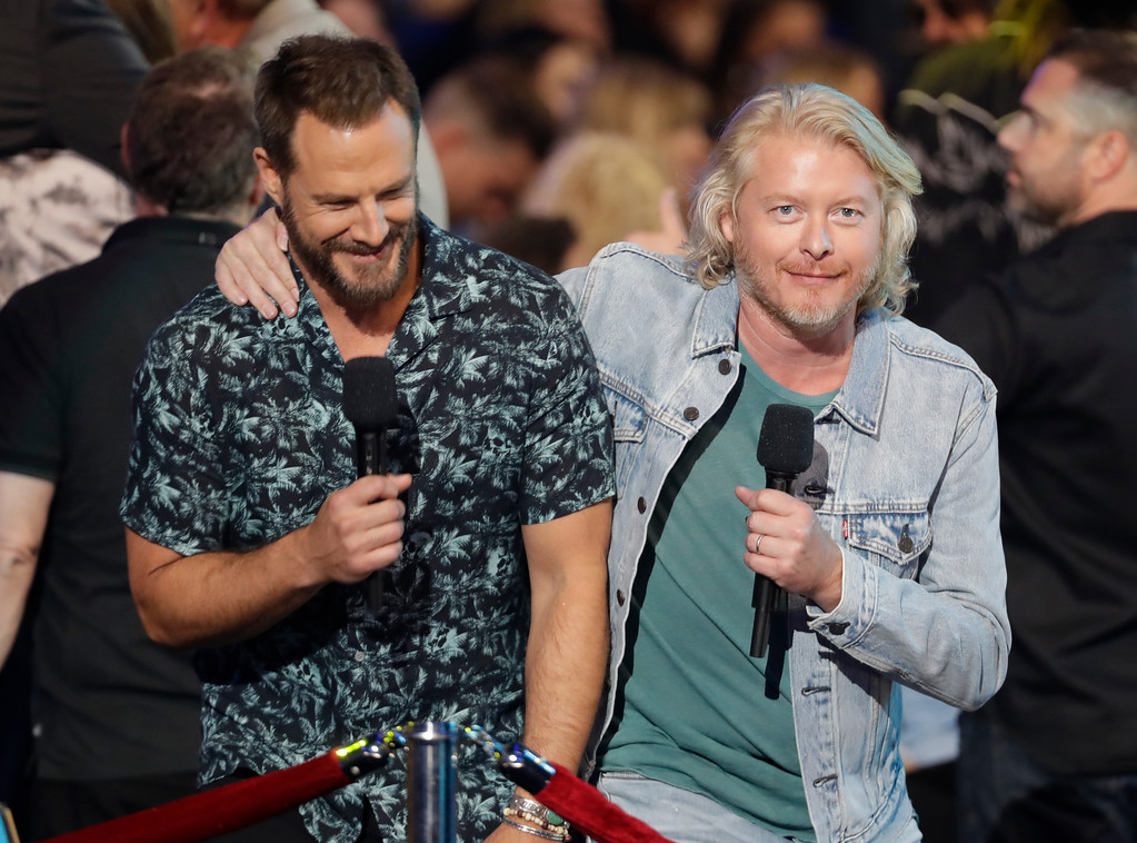 . Jimi Westbrook, left, and Phillip Sweet introduce a performance at the CMT Music Awards at the Bridgestone Arena on Wednesday, June 6, 2018, in Nashville, Tenn. (AP Photo/Mark Humphrey)