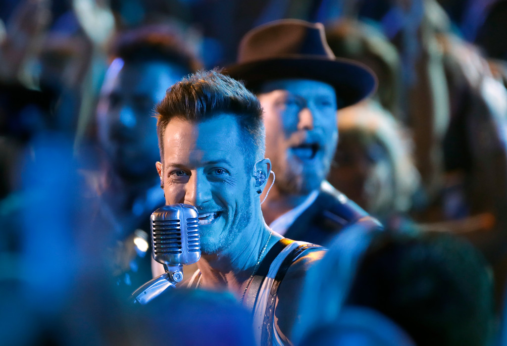 ". Tyler Hubbard, foreground, and Brian Kelley, of Florida Georgia Line, perform ""Simple\"" at the CMT Music Awards at the Bridgestone Arena on Wednesday, June 6, 2018, in Nashville, Tenn. (AP Photo/Mark Humphrey)"