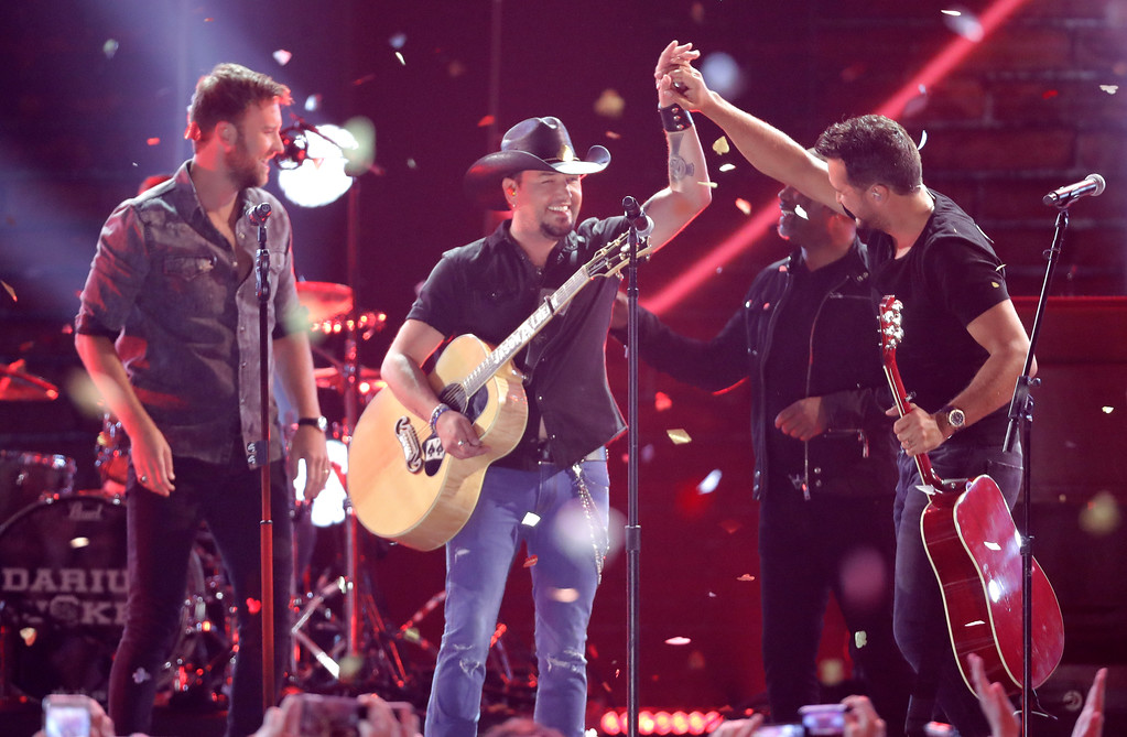 . Charles Kelley, from left, Jason Aldean, Darius Rucker, and Luke Bryan appear on stage at the conclusion of the CMT Music Awards at the Bridgestone Arena on Wednesday, June 6, 2018, in Nashville, Tenn. (AP Photo/Mark Humphrey)
