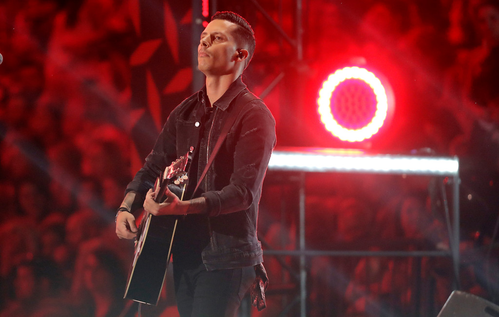 ". Devin Dawson performs ""All On Me\"" at the CMT Music Awards at the Bridgestone Arena on Wednesday, June 6, 2018, in Nashville, Tenn. (AP Photo/Mark Humphrey)"