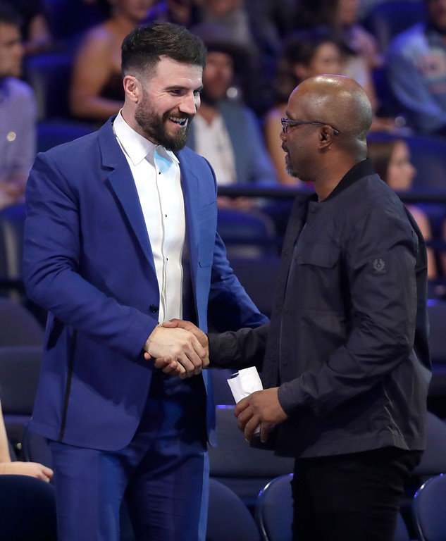 . Sam Hunt, left, and Darius Rucker greet in the audience at the CMT Music Awards at the Bridgestone Arena on Wednesday, June 6, 2018, in Nashville, Tenn. (AP Photo/Mark Humphrey)