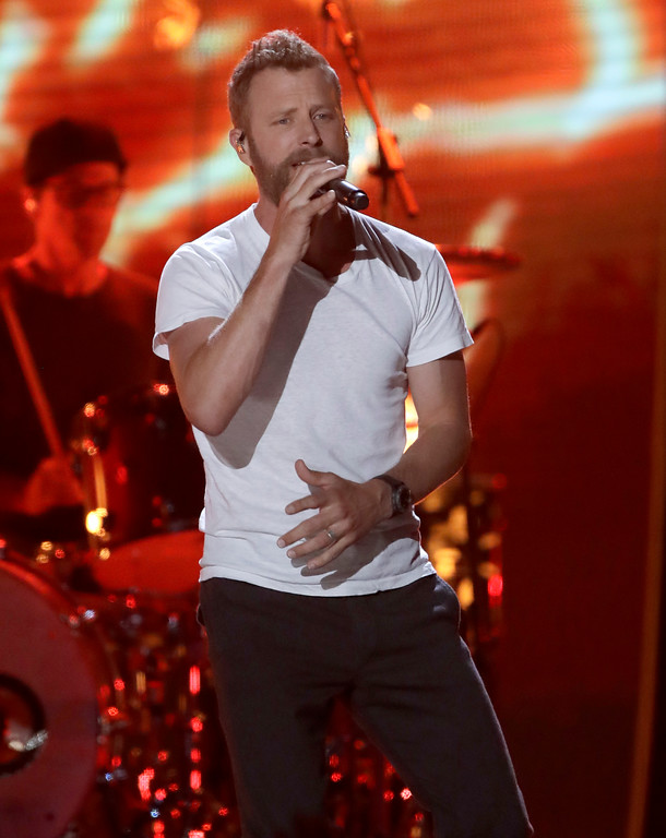 ". Dierks Bentley performs ""Burning Man\"" at the CMT Music Awards at the Bridgestone Arena on Wednesday, June 6, 2018, in Nashville, Tenn. (AP Photo/Mark Humphrey)"