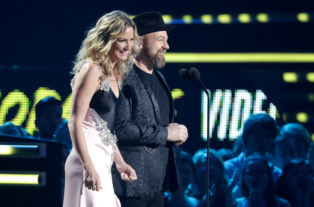 . Jennifer Nettles, left, and Kristian Bush appear on stage to present the collaborative video of the year at the CMT Music Awards at the Bridgestone Arena on Wednesday, June 6, 2018, in Nashville, Tenn. (AP Photo/Mark Humphrey)