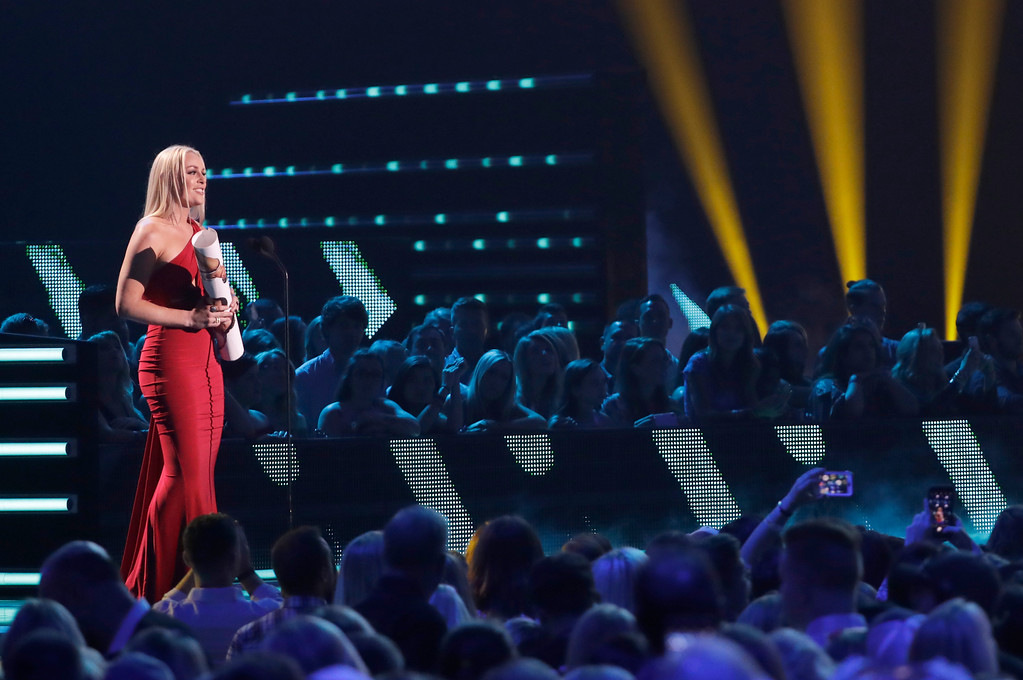. Lindsey Vonn presents a performance at the CMT Music Awards at the Bridgestone Arena on Wednesday, June 6, 2018, in Nashville, Tenn. (AP Photo/Mark Humphrey)