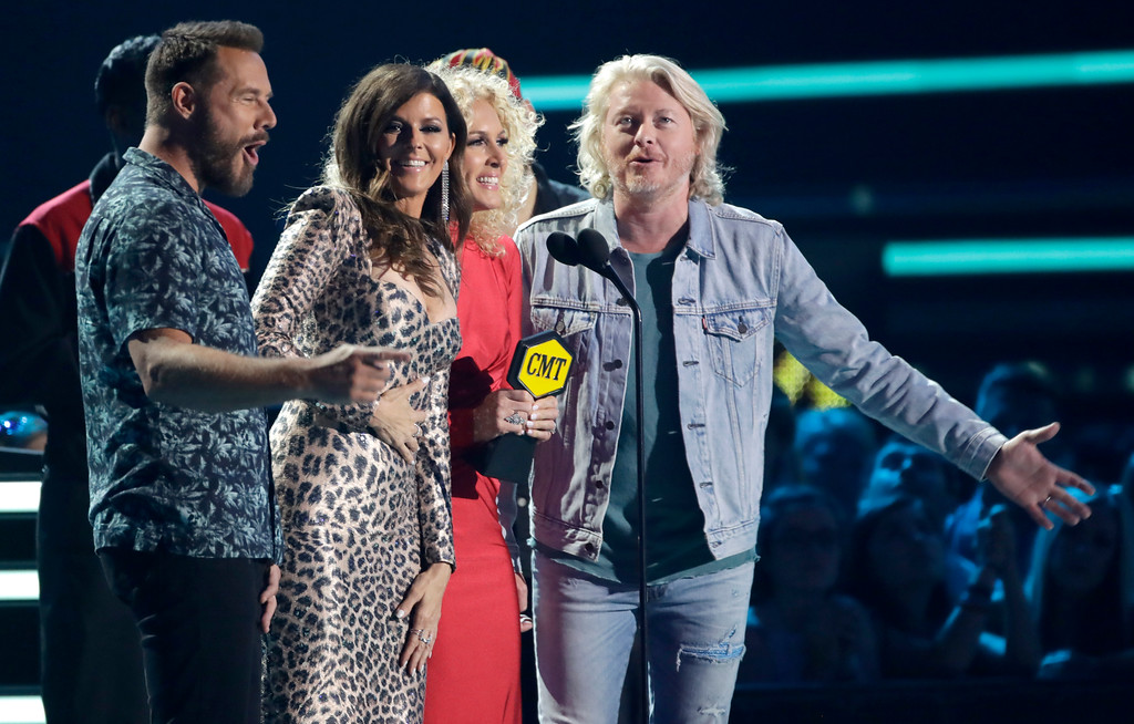 . Jimi Westbrook, from left, Karen Fairchild, Kimberly Schlapman, and Phillip Sweet, of Little Big Town, accept the award for group video of the year at the CMT Music Awards at the Bridgestone Arena on Wednesday, June 6, 2018, in Nashville, Tenn. (AP Photo/Mark Humphrey)