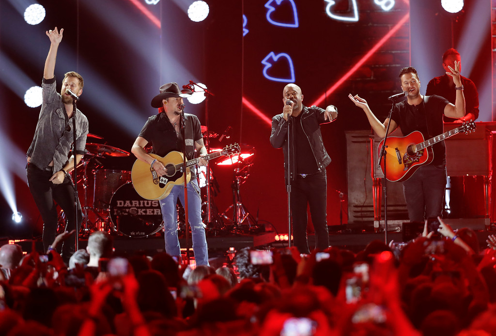 ". Charles Kelley, from left, Jason Aldean, Darius Rucker, and Luke Bryan perform ""Straight To Hell\"" at the CMT Music Awards at the Bridgestone Arena on Wednesday, June 6, 2018, in Nashville, Tenn. (AP Photo/Mark Humphrey)"