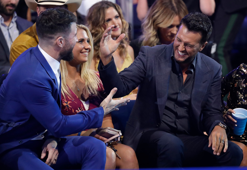 . Sam Hunt, left, and Luke Bryan greet in the audience at the CMT Music Awards at the Bridgestone Arena on Wednesday, June 6, 2018, in Nashville, Tenn. (AP Photo/Mark Humphrey)