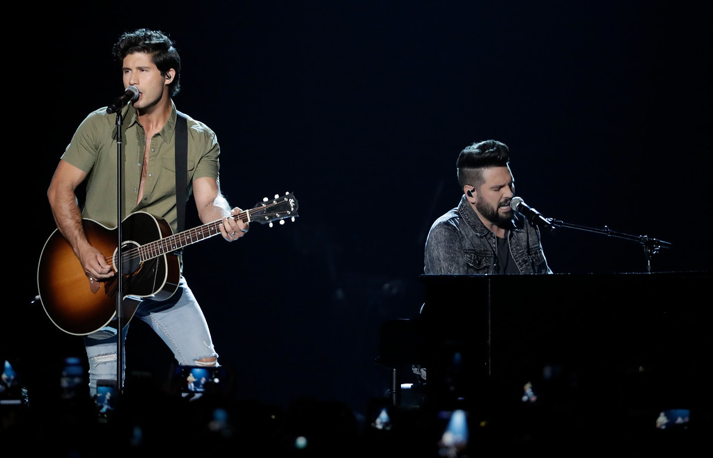 ". Dan Smyers, left, and Shay Mooney of musical group Dan + Shay, perform ""Tequila\"" at the CMT Music Awards at the Bridgestone Arena on Wednesday, June 6, 2018, in Nashville, Tenn. (AP Photo/Mark Humphrey)"
