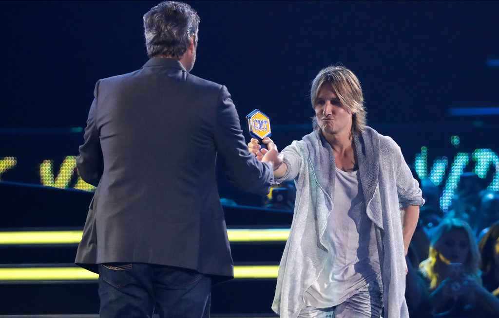 . Blake Shelton accepts the video of the year award from presenter Keith Urban at the CMT Music Awards at the Bridgestone Arena on Wednesday, June 6, 2018, in Nashville, Tenn. (AP Photo/Mark Humphrey)