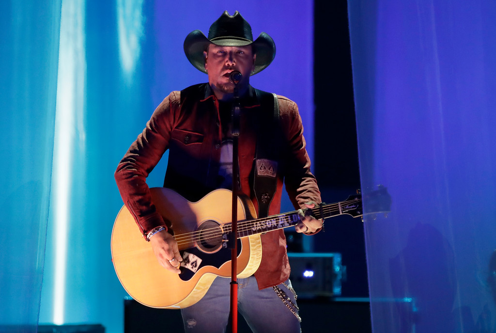 ". Jason Aldean performs ""Drowns the Whiskey\"" at the CMT Music Awards at the Bridgestone Arena on Wednesday, June 6, 2018, in Nashville, Tenn. (AP Photo/Mark Humphrey)"
