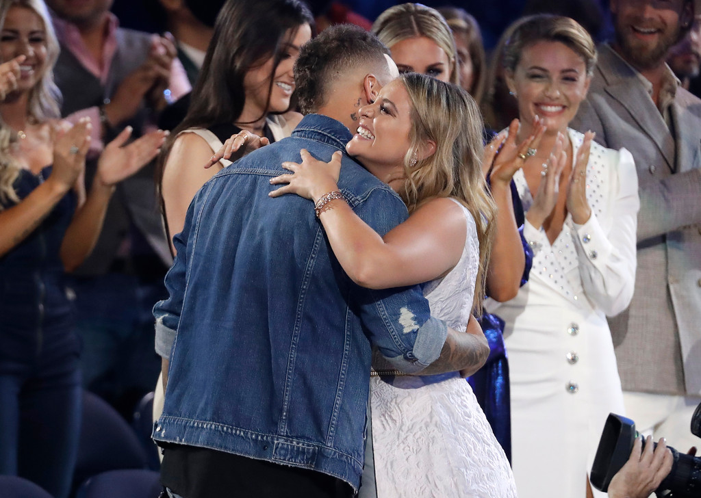 . Kane Brown, left, and Lauren Alaina embrace in the audience after being announced as the winners of the collaborative video of the year award at the CMT Music Awards at the Bridgestone Arena on Wednesday, June 6, 2018, in Nashville, Tenn. (AP Photo/Mark Humphrey)