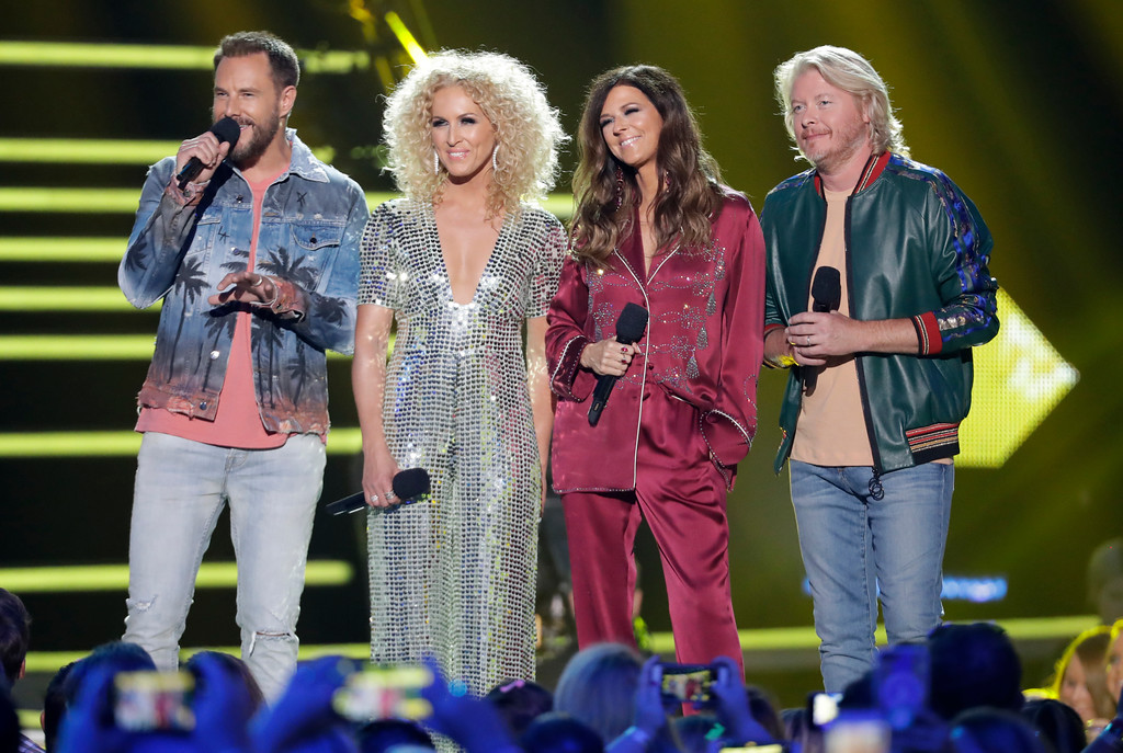 . Jimi Westbrook, from left, Kimberly Schlapman, Karen Fairchild, and Phillip Sweet, of Little Big Town, speak at the CMT Music Awards at the Bridgestone Arena on Wednesday, June 6, 2018, in Nashville, Tenn. (AP Photo/Mark Humphrey)