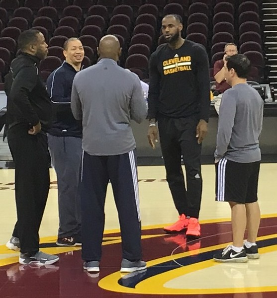 . Cavs coach Tyronn Lue (left, facing camera) joined by LeBron James and various coaches during practice at The Q