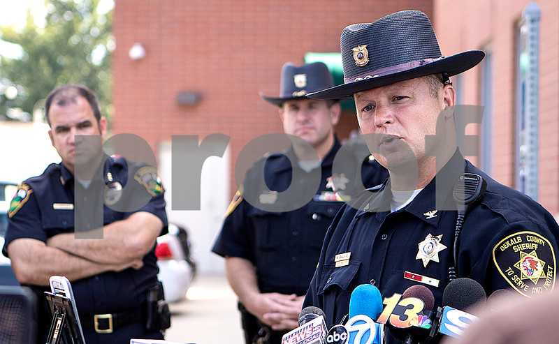 Sam Buckner for Shaw Media.<br /> DeKalb County Chief Deputy Andy Sullivan gives a press conference on Tuesday August 16, 2016 about the double homicide that happened on Old State road.