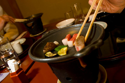 Japanese style dinner, kaiseki ryori, is beeing served in a traditional Japanese restaurant. Kaiseki-ryori is a highly refined style of cooking; traditional Japanese cuisine