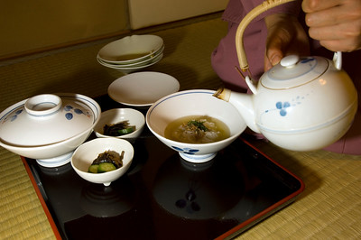 Japanese style dinner, kaiseki ryori, is beeing served in a traditional Japanese restaurant. Kaiseki-ryori is a highly refined style of cooking; traditional Japanese cuisine making chazuke
