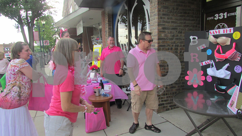 Jane Niesendorf of Maple Park plays a game at Ladies Night Out on Thursday in Sycamore.