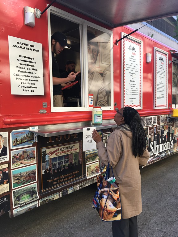 . Ordering a corned beef sandwich, Slyman\'s Tavern food truck, Fan Fest. David S. Glasier - The News-Herald