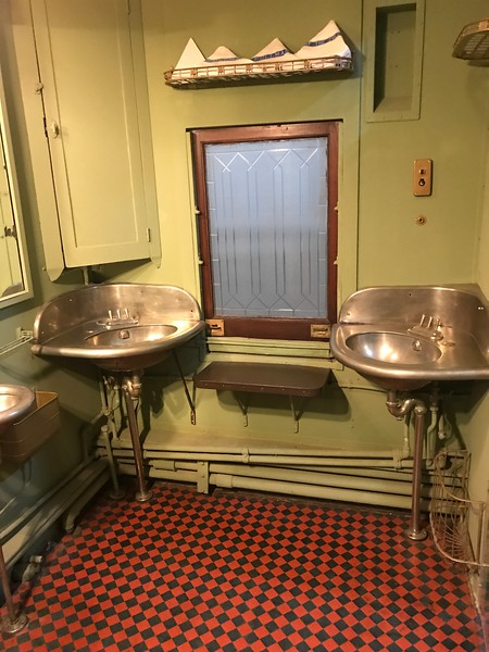 An old bathroom is shown on a train at The National Railroad Museum. (Harley Marsh - The News-Herald)