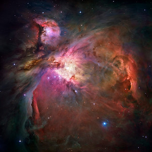 "This dramatic image offers a peek inside a cavern of roiling dust and gas where thousands of stars are forming. The image, taken by the Advanced Camera for Surveys (ACS) aboard NASA/ESA Hubble Space Telescope, represents the sharpest view ever taken of this region, called the Orion Nebula. More than 3,000 stars of various sizes appear in this image. Some of them have never been seen in visible light. These stars reside in a dramatic dust-and-gas landscape of plateaus, mountains, and valleys that are reminiscent of the Grand Canyon. The Orion Nebula is a picture book of star formation, from the massive, young stars that are shaping the nebula to the pillars of dense gas that may be the homes of budding stars. The bright central region is the home of the four heftiest stars in the nebula. The stars are called the Trapezium because they are arranged in a trapezoid pattern. Ultraviolet light unleashed by these stars is carving a cavity in the nebula and disrupting the growth of hundreds of smaller stars. Located near the Trapezium stars are stars still young enough to have disks of material encircling them. These disks are called protoplanetary disks or ""proplyds"" and are too small to see clearly in this image. The disks are the building blocks of solar systems. The bright glow at upper left is from M43, a small region being shaped by a massive, young star's ultraviolet light. Astronomers call the region a miniature Orion Nebula because only one star is sculpting the landscape. The Orion Nebula has four such stars. Next to M43 are dense, dark pillars of dust and gas that point toward the Trapezium. These pillars are resisting erosion from the Trapezium's intense ultraviolet light. The glowing region on the right reveals arcs and bubbles formed when stellar winds - streams of charged particles ejected from the Trapezium stars - collide with material. The faint red stars near the bottom are the myriad brown dwarfs that Hubble spied for the first time in the nebula in visible light. Sometimes called ""failed stars,"" brown dwarfs are cool objects that are too small to be ordinary stars because they cannot sustain nuclear fusion in their cores the way our Sun does. The dark red column, below, left, shows an illuminated edge of the cavity wall. The Orion Nebula is 1,500 light-years away, the nearest star-forming region to Earth. Astronomers used 520 Hubble images, taken in five colours, to make this picture. They also added ground-based photos to fill out the nebula. The ACS mosaic covers approximately the apparent angular size of the full moon. The Orion observations were taken between 2004 and 2005."