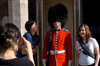 Tourists posing by a guard at St James's Palace, London, United Kingdom
