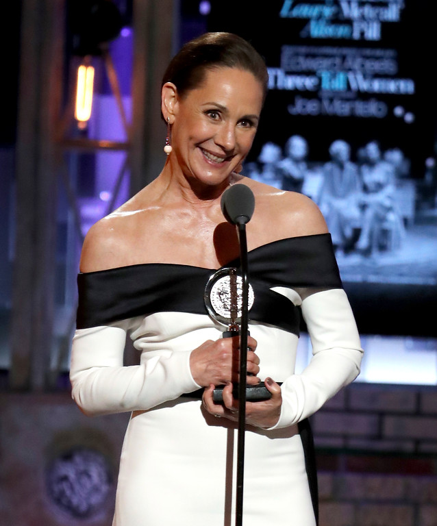 ". Laurie Metcalf accepts the award for best featured actress in a play for ""Edward Albee\'s Three Tall Women\"" at the 72nd annual Tony Awards at Radio City Music Hall on Sunday, June 10, 2018, in New York. (Photo by Michael Zorn/Invision/AP)"
