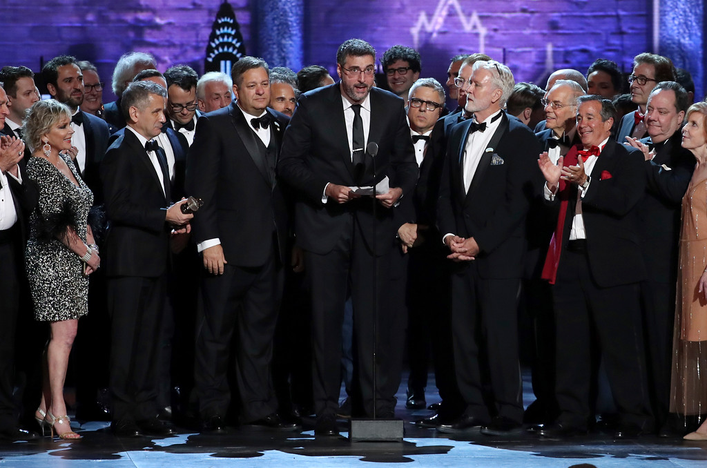 ". Orin Wolf, center, and the cast and crew of ""The Band\'s Visit\"" accept the award for best musical at the 72nd annual Tony Awards at Radio City Music Hall on Sunday, June 10, 2018, in New York. (Photo by Michael Zorn/Invision/AP)"
