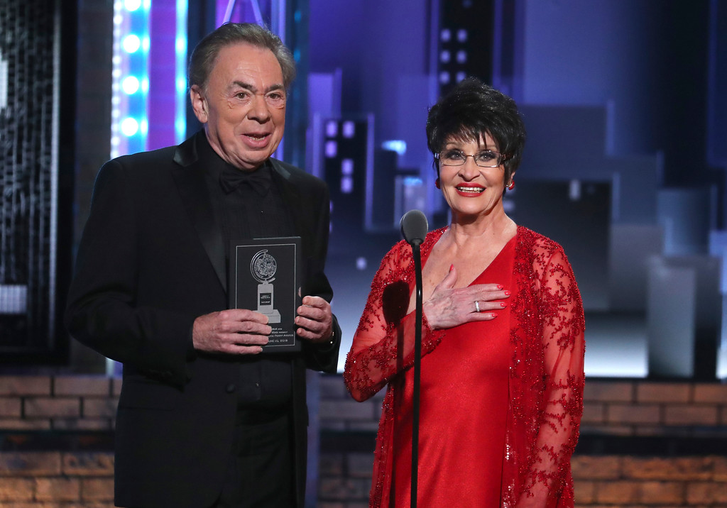 . Andrew Lloyd Webber, left, and Chita Rivera present the award for best director of a musical at the 72nd annual Tony Awards at Radio City Music Hall on Sunday, June 10, 2018, in New York. (Photo by Michael Zorn/Invision/AP)