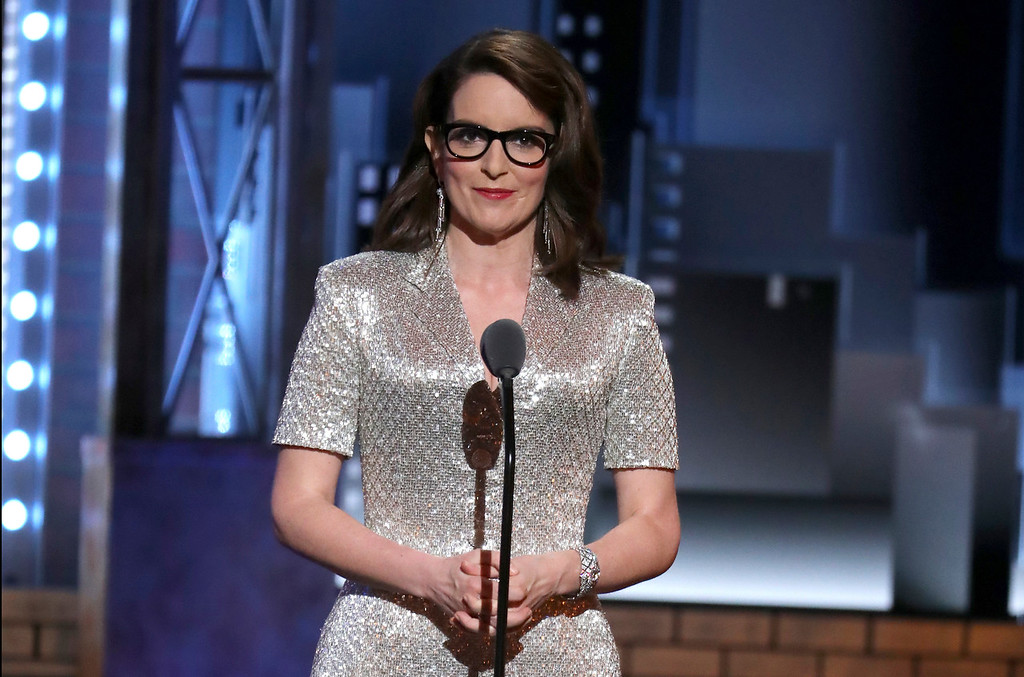 ". Tina Fey introduces a performance by the cast of ""Mean Girls\"" at the 72nd annual Tony Awards at Radio City Music Hall on Sunday, June 10, 2018, in New York. (Photo by Michael Zorn/Invision/AP)"