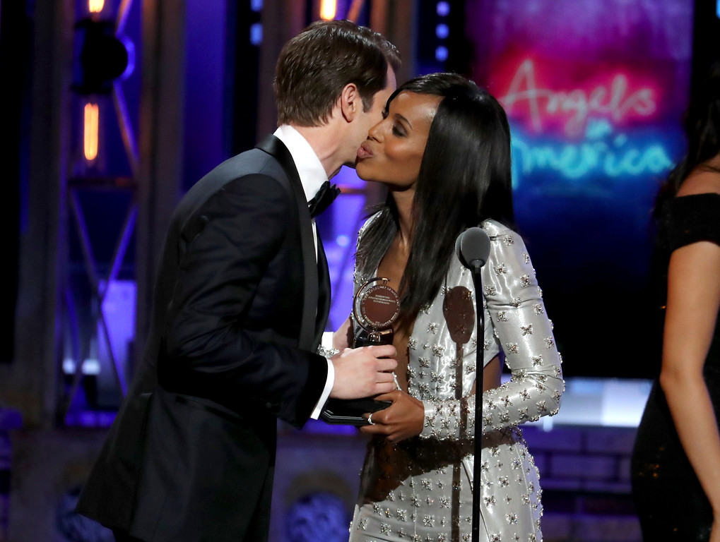 ". Andrew Garfield, left, kisses presenter Kerry Washington as he accepts the award for best leading actor in a play for ""Angels in America\"" at the 72nd annual Tony Awards at Radio City Music Hall on Sunday, June 10, 2018, in New York. (Photo by Michael Zorn/Invision/AP)"