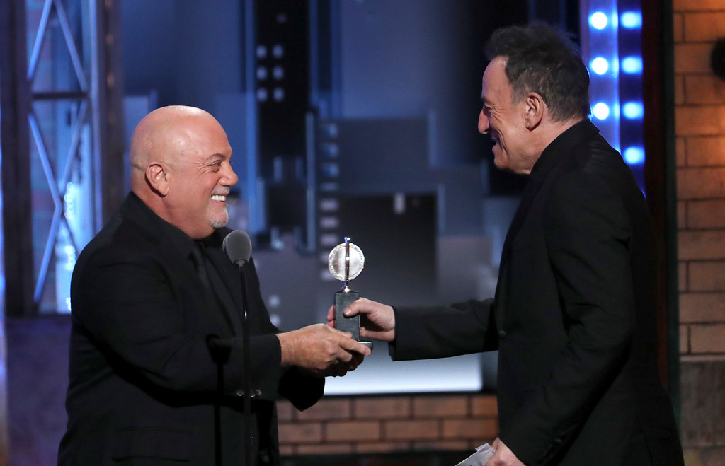. Billy Joel, left, presents the Special Tony award to Bruce Springsteen at the 72nd annual Tony Awards at Radio City Music Hall on Sunday, June 10, 2018, in New York. (Photo by Michael Zorn/Invision/AP)