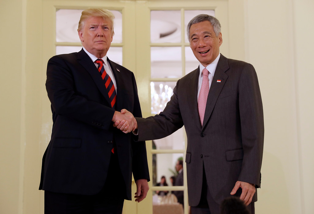 . President Donald Trump shakes hands as he meets with Singapore Prime Minister Lee Hsien Loong ahead of a summit with North Korean leader Kim Jong Un, Monday, June 11, 2018, in Singapore. (AP Photo/Evan Vucci)