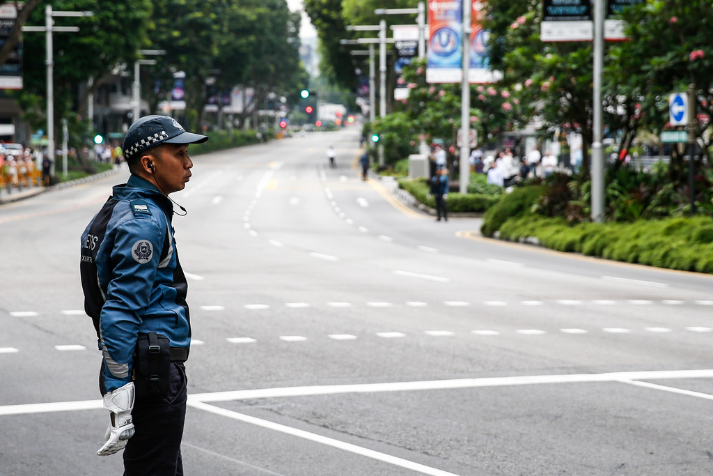 . A police officer stands guard along the road outside the St. Regis Hotel in Singapore, Tuesday, June 12, 2018, ahead of the summit between U.S. President Donald Trump and North Korea leader Kim Jong Un. (AP Photo/Yong Teck Lim)