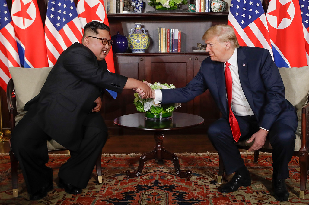 . U. S. President Donald Trump shakes hands with North Korea leader Kim Jong Un during their first meetings at the Capella resort on Sentosa Island Tuesday, June 12, 2018 in Singapore. (AP Photo/Evan Vucci)