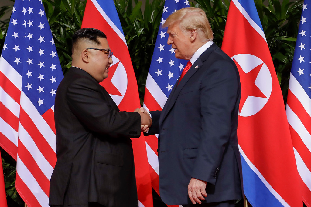 . U.S. President Donald Trump shakes hands with North Korea leader Kim Jong Un at the Capella resort on Sentosa Island Tuesday, June 12, 2018 in Singapore. (AP Photo/Evan Vucci)