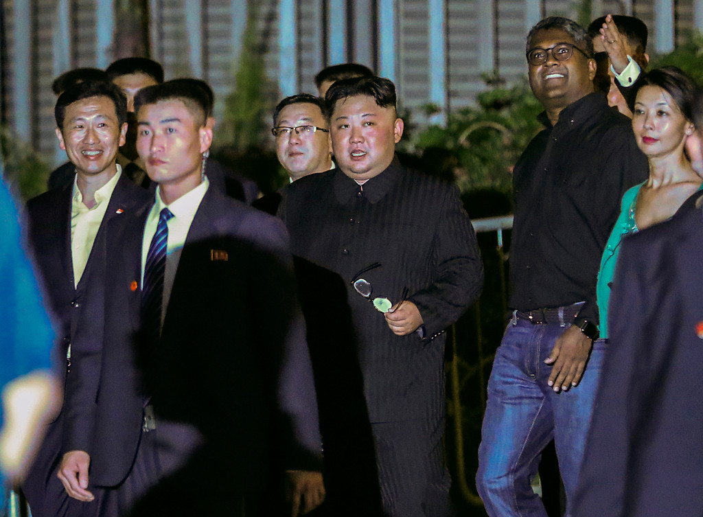 . North Korea leader Kim Jong Un, center, is escorted by his security delegation as he visits Marina Bay in Singapore, Monday, June 11, 2018, ahead of Kim\'s summit with U.S. President Donald Trump. (AP Photo/Yong Teck Lim)