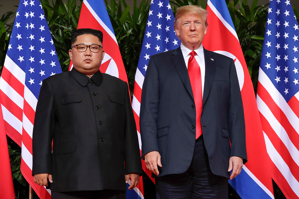 . U. S. President Donald Trump stands with North Korea leader Kim Jong Un for a photograph at the Capella resort on Sentosa Island Tuesday, June 12, 2018 in Singapore. (AP Photo/Evan Vucci)