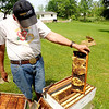 Jonathan Tressler - The News-Herald. Hambden Township resident and longtime beekeeper Dave Paterson shows off some of the fruits of one of his hives' labor in this June 7 photo.