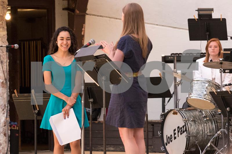 Sam Buckner for Shaw Media.<br /> Destinee Feliciano receives the Palmer Family Music Education scholarship on Tuesday, June 13, 2017.