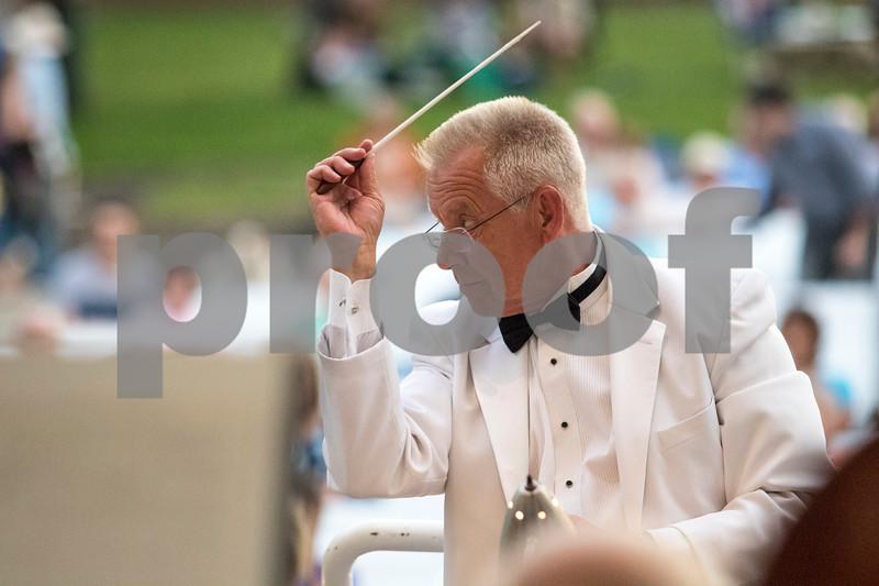 Sam Buckner for Shaw Media.<br /> DeKalb Municipal Band director Kirk Lundbeck conducts the band on Tuesday, June 13, 2017.