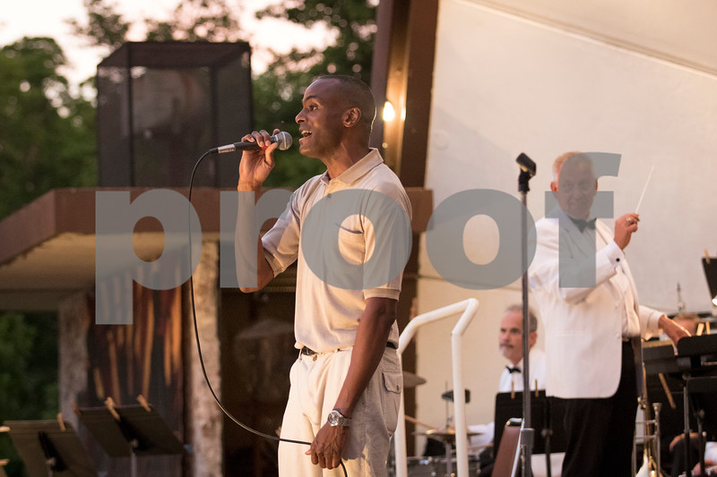 Sam Buckner for Shaw Media.<br /> Guest singer Zach Harris sings on Tuesday, June 13, 2017 at the Dekalb Municipal Bands opening summer concert.
