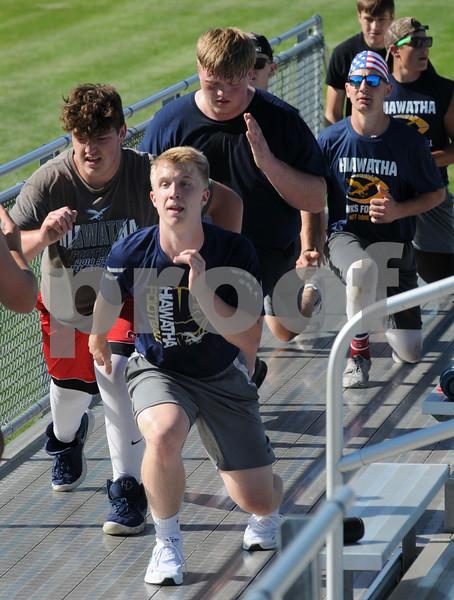 Hiawatha High School running back Kyle Thompson (front) and his football teammates go through drills on Thursday in Kirkland.  Steve Bittinger - For Shaw Media