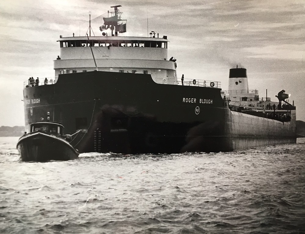 . The Morning Journal <br> This photo shows a tug leading the vessel Roger Blough out of Lorain.