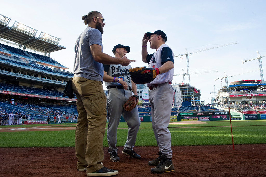 . U.S. Rep. Steve Scalise, R-Louisiana, right, talks with Washington Nationals outfielder Jayson Werth, left, before the start of the 57th Congressional Baseball Game at National\'s Park in Washington, Thursday, June 14, 2018. On June 14, 2017, Congressional members were victims of a shooting at the baseball field they were practicing on in Alexandria, Va. (AP Photo/Cliff Owen)