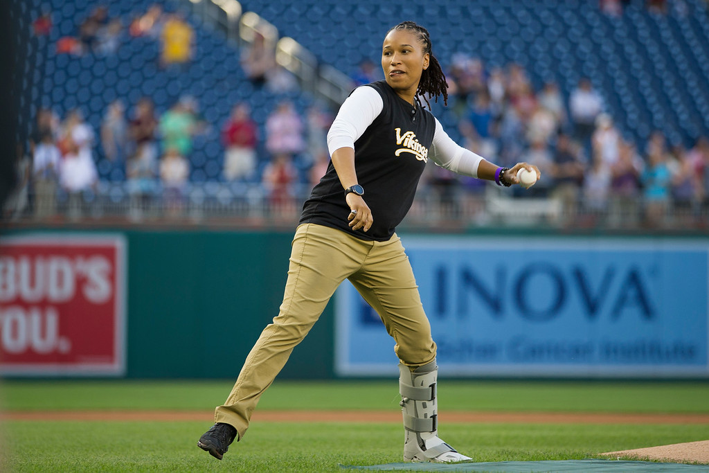 . Capitol Hill Police Special Agent Crystal Griner throws out the first pitch to start the 57th Congressional Baseball Game at National\'s Park in Washington, Thursday, June 14, 2018. On June 14, 2017, Congressional members were victims of a shooting at the baseball field they were practicing on in Alexandria, Va. (AP Photo/Cliff Owen)