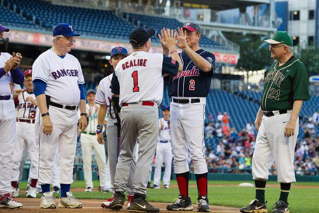 . Rep. Steve Scalise, R-Louisiana, center, is announced onto the field at the start of the 57th Congressional Baseball Game at National\'s Park in Washington, Thursday, June 14, 2018. On June 14, 2017, Scalise and some other Congressional members were victims of a shooting at the baseball field they were practicing on in Alexandria, Va. (AP Photo/Cliff Owen)